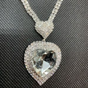 Jewelry - Puffed pave heart with large center stone